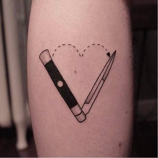 Hand poked knife tattoo.