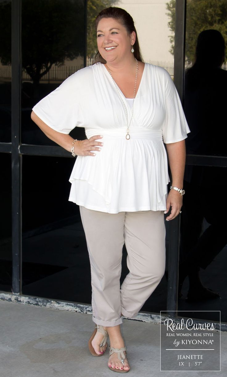 """The Showroom manager Jeannette (5'7"""" and a size 1x) sports a clean and sharp looking outfit in our plus size Promenade Top.  This neutral win looks fantastic from her cuffed khaki pants to her pulled back hair.  To keep with the simplicity, she opted for easy accessories that let the outfit shine. www.kiyonna.com  #KiyonnaPlusYou  #Plussize  #MadeintheUSA #Kiyonna  #OOTD"""