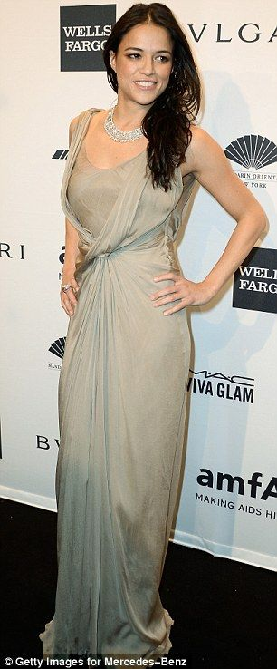 Gown and out: The 35-year-old Fast & Furious star looked glamorous in a pearl-coloured silk dress