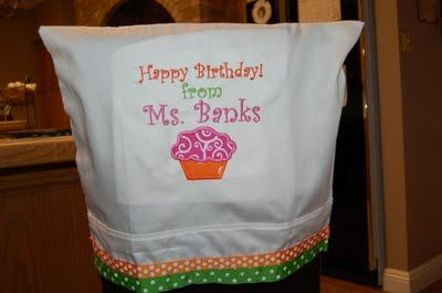 How cute is this?  Birthday chair cover made from a pillowcase.  Lots of embroidery ideas on this blog.