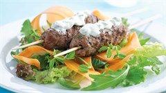 Beef skewers carrot salad