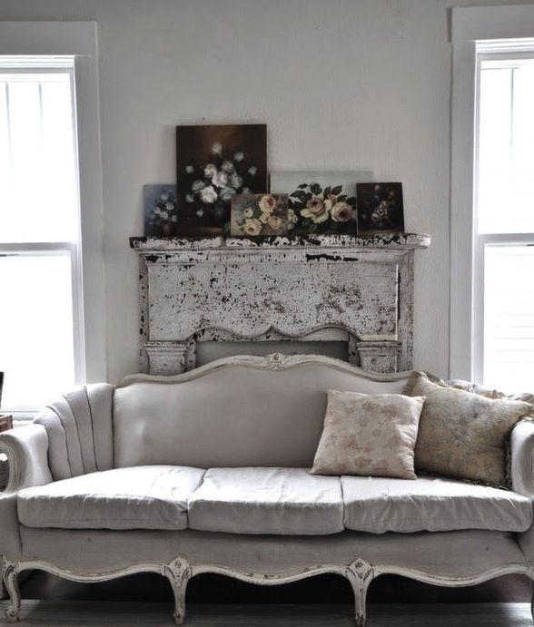 Such a gorgeous vintage sofa: and teamed with the chippy old fire place; and the rose painting collection: love it ♥