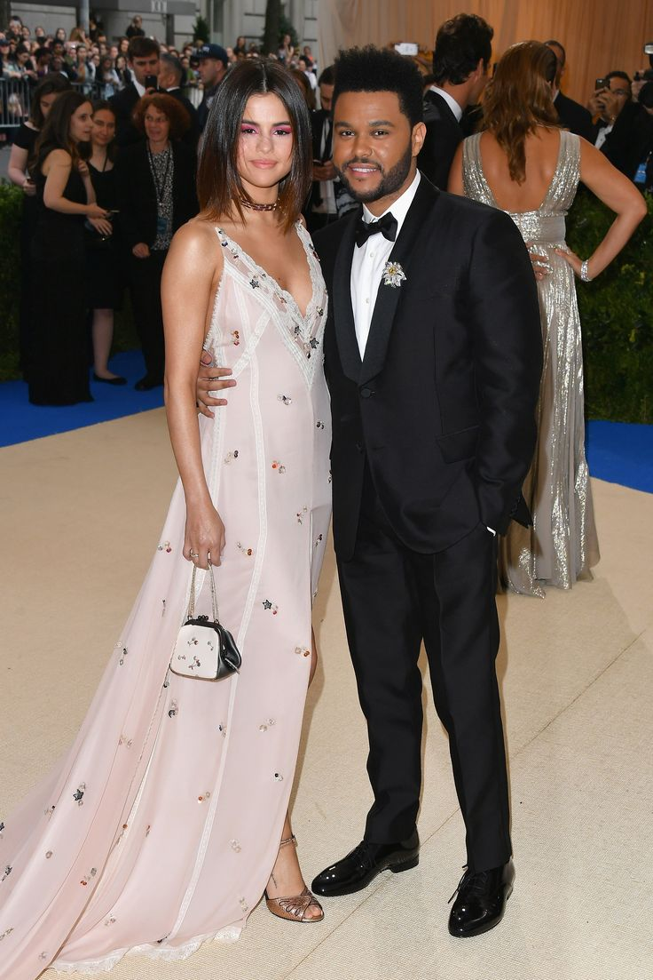 This is such a fun look***Selena Gomez in Coach and Tiffany jewelry and The Weeknd in a Valentino tuxedo