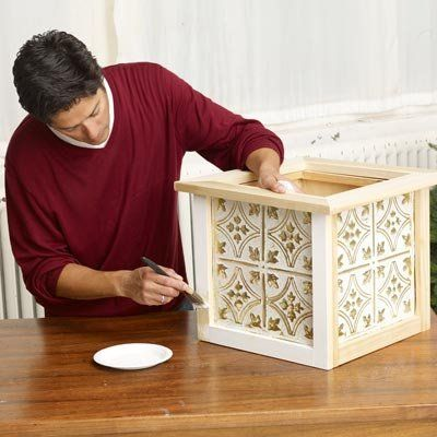 Learn how to use wood and tin ceiling tiles to construct an ornate Christmas tree box!