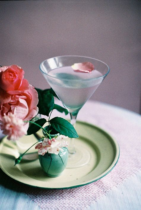 Rose Martini                                                      Ingredients  1 1/2 oz. vodka 1 oz. white crème de cacao 1/4 oz. rosewater small pieces of Turkish delight or rose petals to garnish 1 drop rose food color