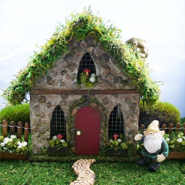 Gnome HOme Fairy House and gold mine of ideas for doors, windows, ect.