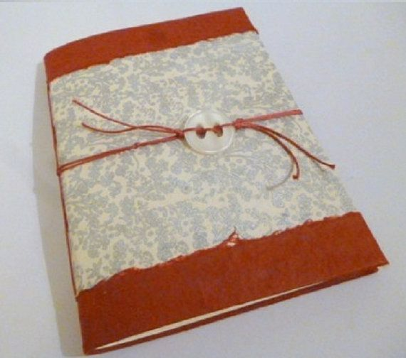 Quaderno portafoto con pagine interne di TRACCEBOTTEGAARTIGIA