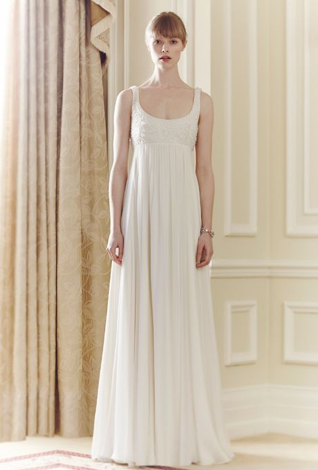 Brides: Jenny Packham. Floor length beaded and chiffon gown, with spaghetti straps, and empire silhouette.