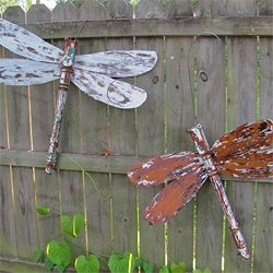 I could sit and look at Lucy's repurposed dragonflies all day! Table legs, ceiling fan blades, and fabulous paint technique.
