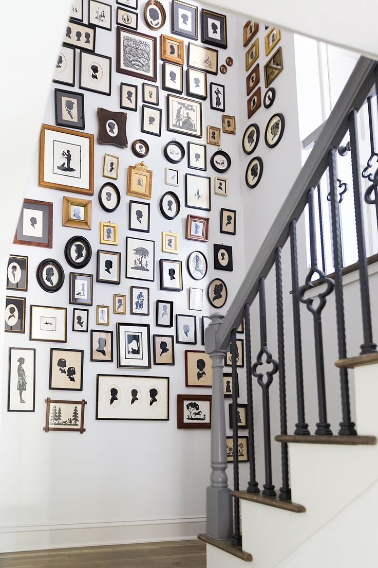 This is a great way to display collections! Wedding designer Calder Clark displays her collection of silhouettes on the walls in her stairway—115 in total!