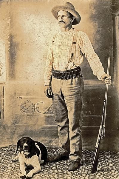 In this circa 1900-1905 cabinet card, this plainly dressed sportsman models with his hunting dog and a cartridge belt full of ammunition for his standard-grade Winchester Model 1895 lever-action, repeating magazine rifle. A John Browning design, this mode