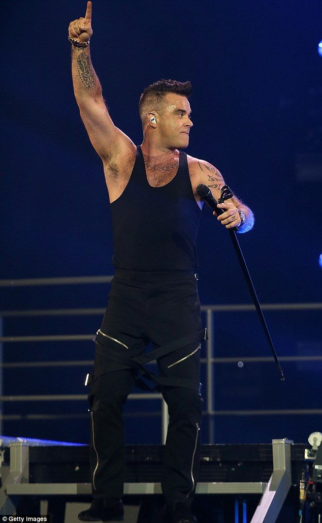 Stage presence: The 41-year-old wore a black vest with matching trousers which featured silver zippers