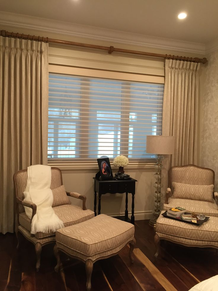 A neutral blend of Hunter Douglas Silhouettes with drapery. Great combination of effieciency and style.