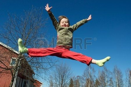 Happy jumping girl on a blue sky background