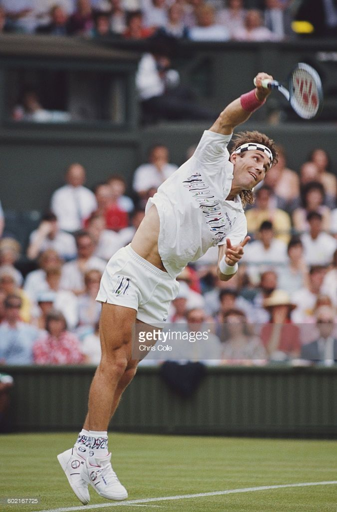 Pat Cash of Australia serves against Boris Becker during their Quarter Final match of the Men's Singles at the Wimbledon Lawn Tennis Championship on 30 June 1988 at the All England Lawn Tennis and Croquet Club in Wimbledon, London, England.
