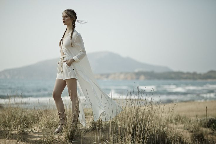maxi white shirt paired with white shorts and a rope belt