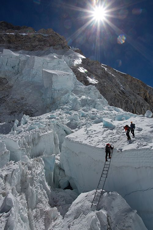 The Khumbu Ice Fall... at an altitude of 18,000 feet... on the way up Everest ...Photography by Jon Griffith
