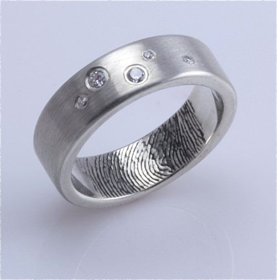 fingerprint wedding ring. A really sweet idea.