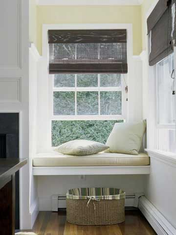 The open design of this niche window seat accommodates the baseboard heaters below.