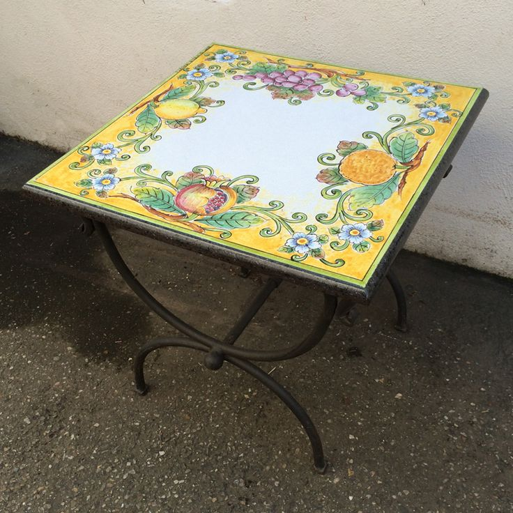 Italian Volcanic Outdoor Table with Iron Base – Mixed fruits on a yellow background. This beautiful and virtually indestructible volcanic aggregate table is harder than granite, is all-weather safe and made to last a lifetime. Expert Italian artisans transform the carved volcanic stone using the same skills developed during centuries of fine ceramic artistry – but these high-fired tables are NOT CERAMIC! They are made to be left outside year 'round – rain, snow or shine!