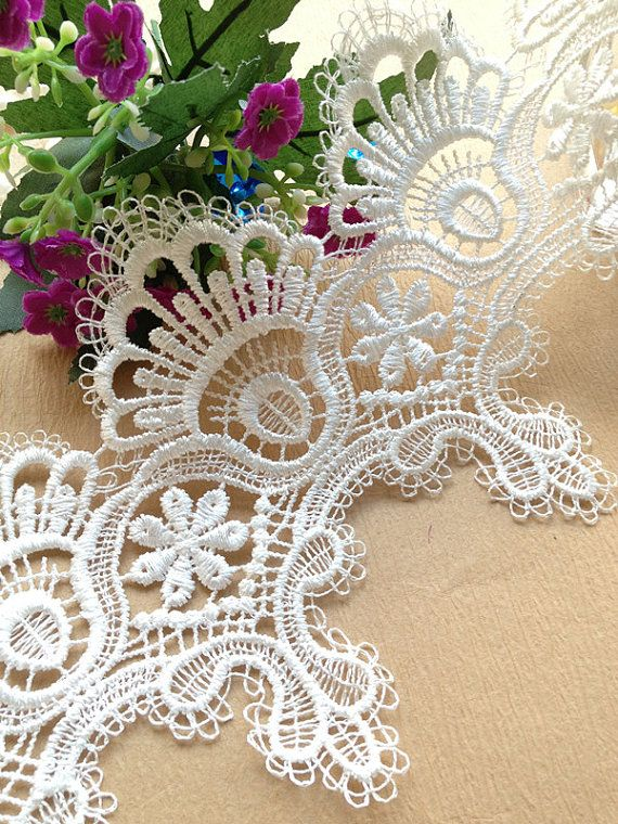 1 yard White Embroidery Lace Trim for Dress making, Wedding Supplies and Home Decoration    Made of cotton and nylon mix.    This listing is for 1