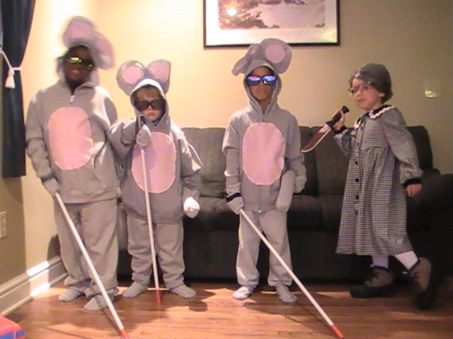three blind mice!  I wouldn't use the carving mice costume.  I prefer to newer more kid friendly (non-violent) nursery rhymes, but the mice are clever.