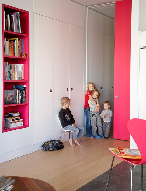 Built in wardrobe and built in pink shelves.