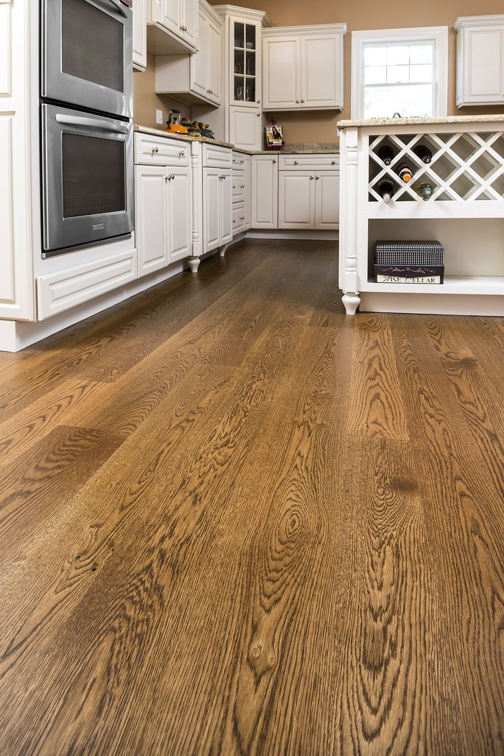 Wide Plank White Oak Finished With Medium Brown Stain And