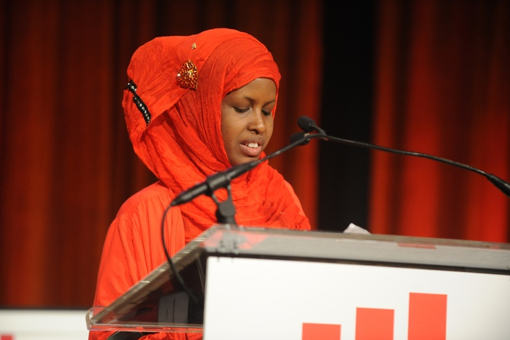 Dahabo accepts her 2013 Voices of Courage Award for her leadership in providing skills training to young refugee girls with disabilities.