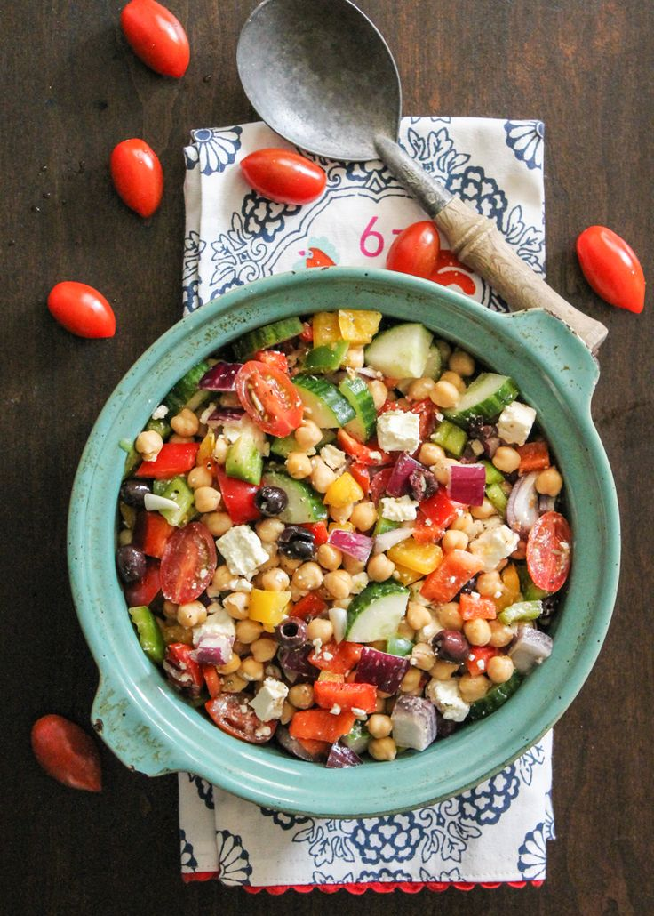 Vegetarian Chickpea salad with olives, feta, tomatoes, onion, garlic and a light lemon dressing! Add quinoa for more protein or enjoy on it's own!