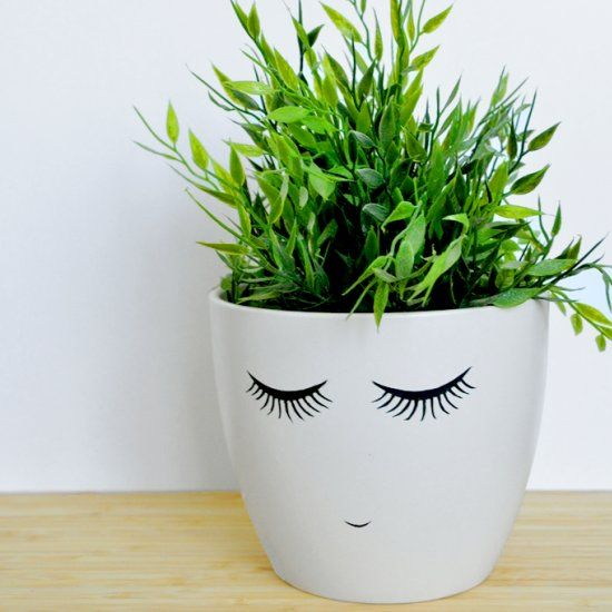 A quick and easy DIY to turn a boring plant pot into the most lovable thing.