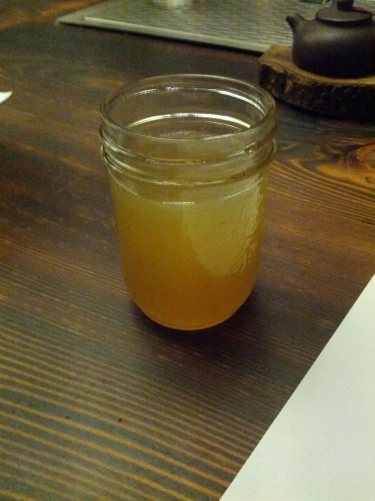 A glass of jun, a kombucha-like drink, except that is cultured from green tea and dandelion honey. At O5 Rare Teas.