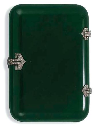 AN ART DECO JADE AND DIAMOND CIGARETTE CASE  The nephrite jade case with rose-cut diamond openwork hinges and clasp of geometric design, circa 1920, 8.8 cm. wide, with maker's mark and French assay marks for platinum and gold