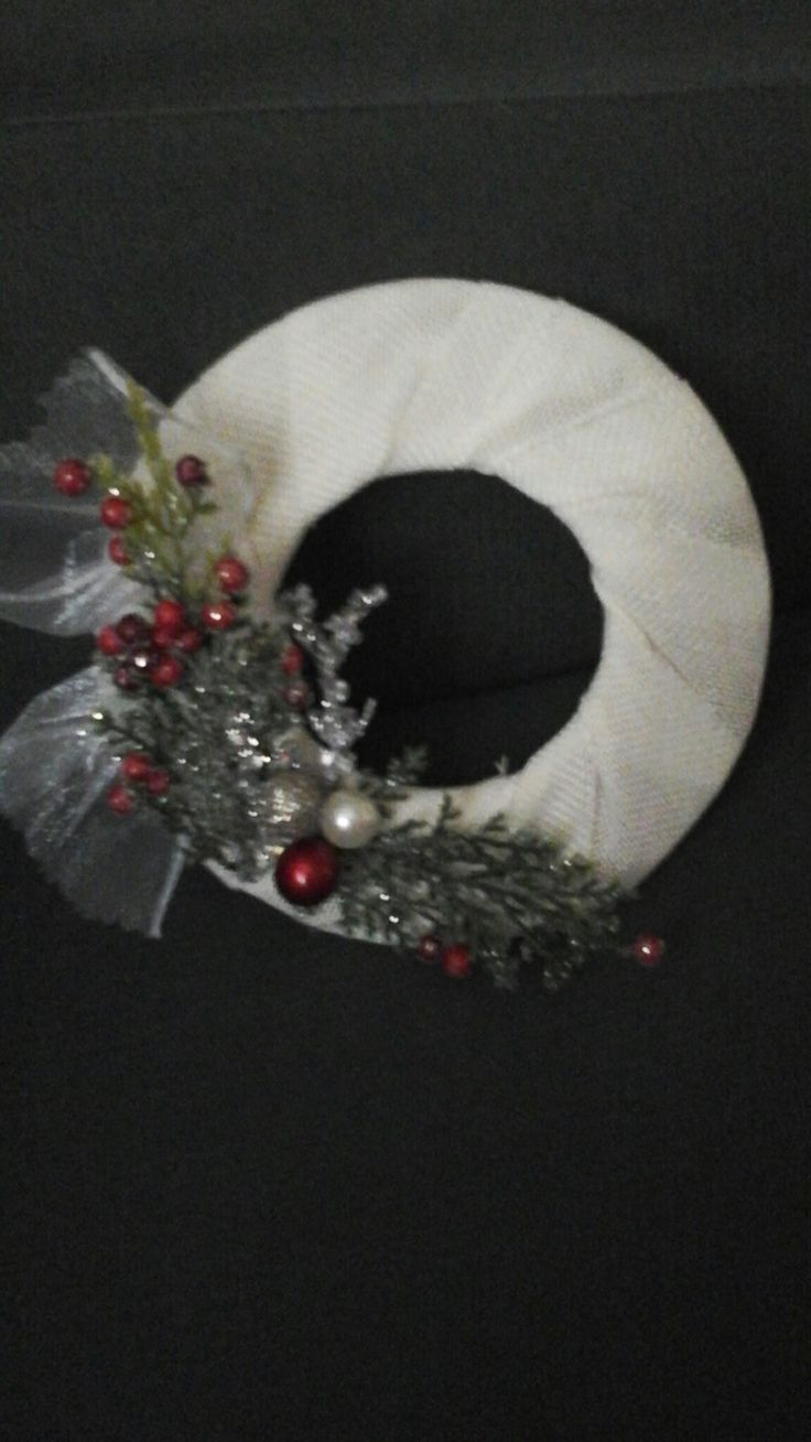 Wooden wreath, cover with material, add christmas/winter accessories. August  2016.