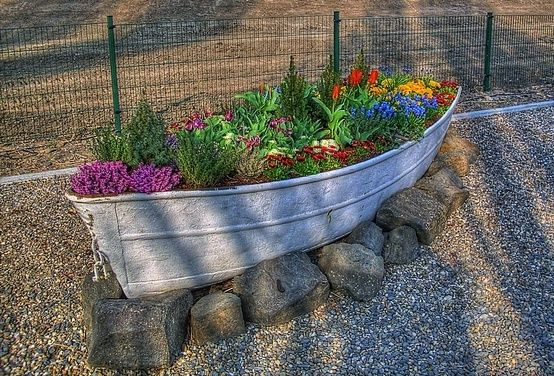 old boat, colorful flowers