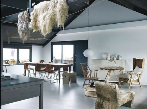 A World Apart-Dutch felt artist Paula Leen and Kees Middendorp's living space in the Netherlands is peppered with an assortment of objects and textures, including sheep's wool, an antique French farmhouse table, salvaged chairs, a Glo-Ball light by Jasper Morrison for Flos, and an Axel leather sofa by Gijs Papavoine for Montis. Photo by: Hotze Eisma