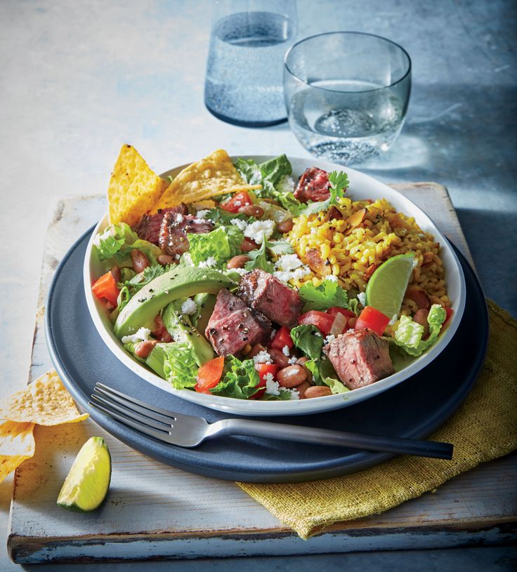 This gluten-free take on a taco salad uses seared flank steak in place of ground beef. Instead of a fried tortilla shell, crisp romaine l...