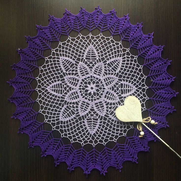 Handmade crochet doily with modern pattern and violet color