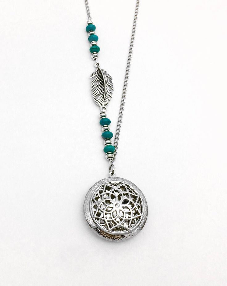Excited to share the latest addition to my #etsy shop: Silver Feather Diffuser Necklace, Turquoise Howlite Essential Oil Diffuser Necklace, Feather Locket Aromatherapy Necklace, Oil Gift for Her