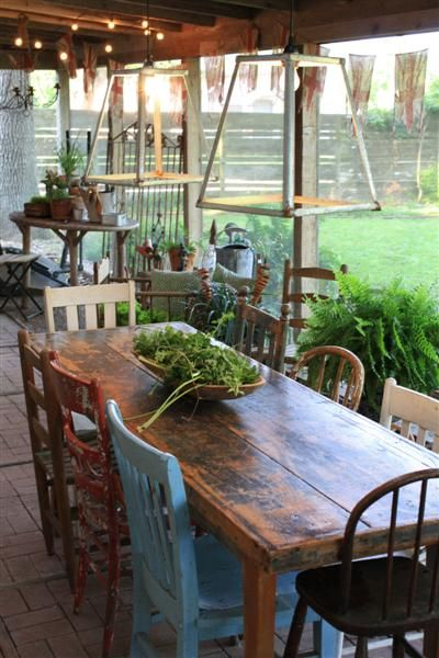 Back porch table and chairs. Chairs are all different! LOVE IT!