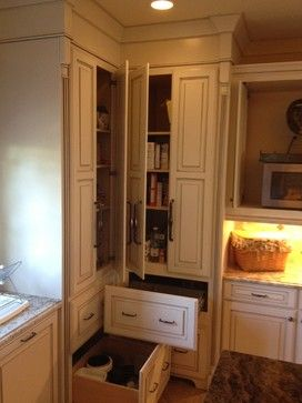 Mediterranean Remodel, custom pantries hide warming drawer, pots and pans storage, under cabinet lighting.  Toe space is build flush as a valance by Kabinart, Project by Phil Johnson