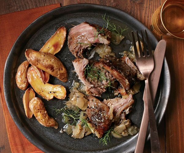 Braised pork shoulder with fennel, garlic, and herbs recipe - Fine Cooking