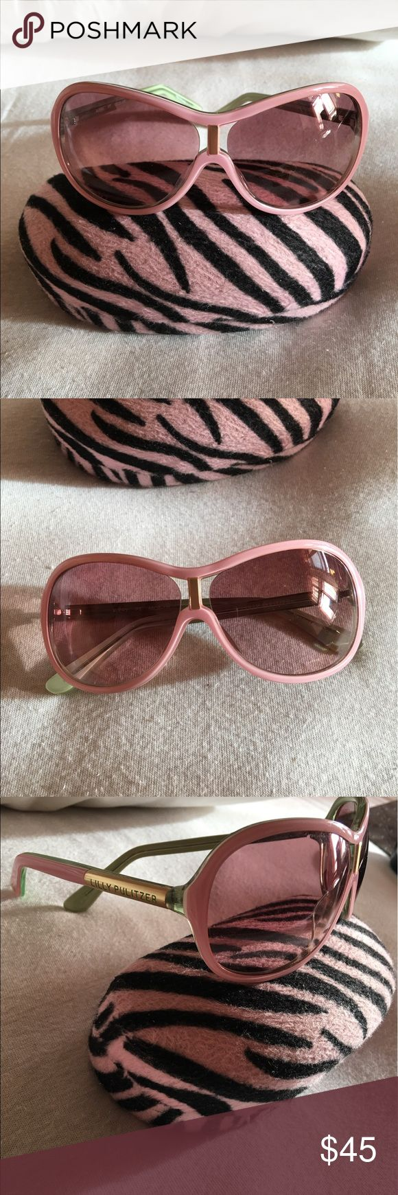 LILLY PULITZER Sunglasses Adorable Pink Rimmed Lilly Pulitzer Sunglasses. 100% Authentic. Style Name: AVERY. Pink rims with green detail. Light brown tint. Comes with pink zebra design case. In great pristine condition. No damage, no scratches. Lens are perfect with no scratches. Barely used and just stored. Lilly Pulitzer Accessories Sunglasses
