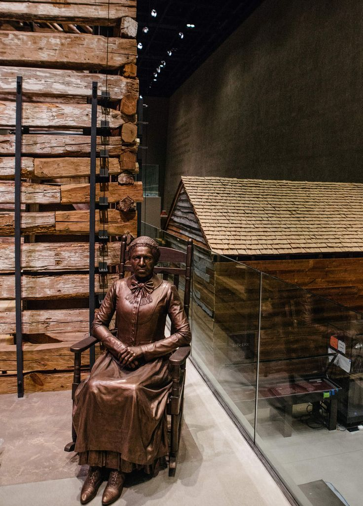 The National Museum of African American History and Culture - STATUE OF CLARA BROWN After Brown was freed from slavery, she moved to Colorado, where she became an important community leader, helping other former slaves to settle there. The slave cabin to the right, from about 1853, had been on Edisto Island in South Carolina.