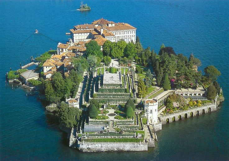 Isola Bella, Italy Standing on the upper tier of the gardens and gazing over the beautiful lake nestled in the Alps was....PURE HEAVEN!