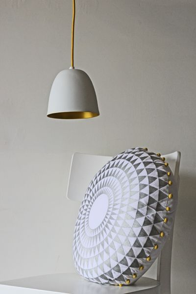 White porcelain ceiling light with gold interior and yellow flex rocket st george