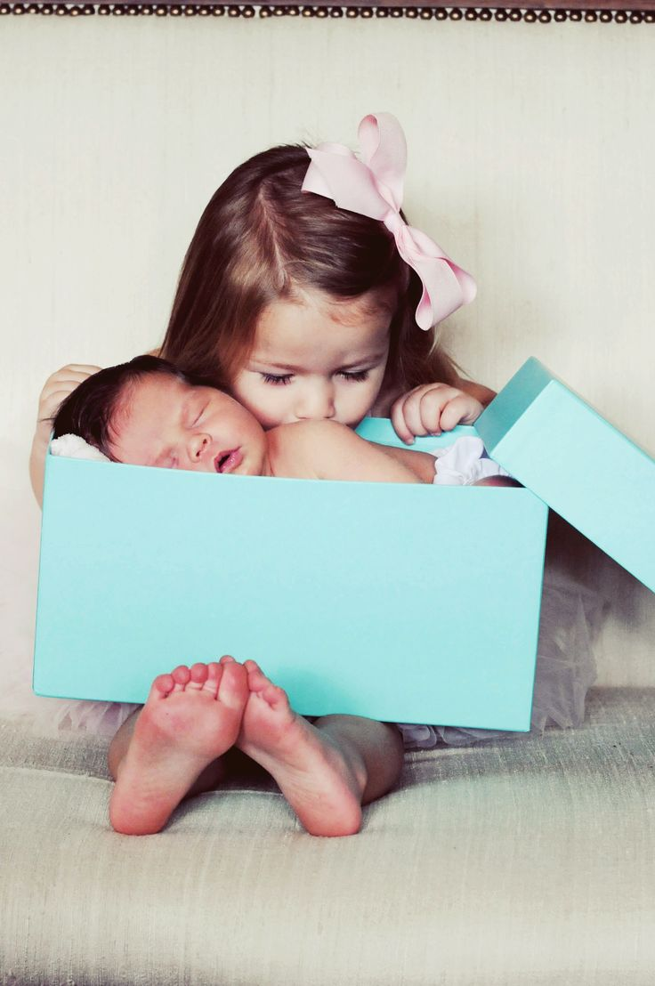 Newborn photography. Tiffany's box & kisses from her big sister. #newborn #photography #tiffanys
