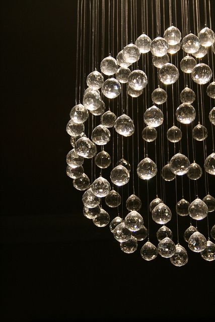 Non traditional chandelier with crystal globes hanging down to catch the light