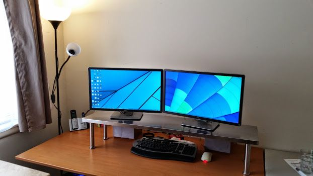 """Stainless Steel Monitor Stand from 8.25"""" CAPITA legs attached to an EKBY MOSSBY shelf (200.570.00)."""