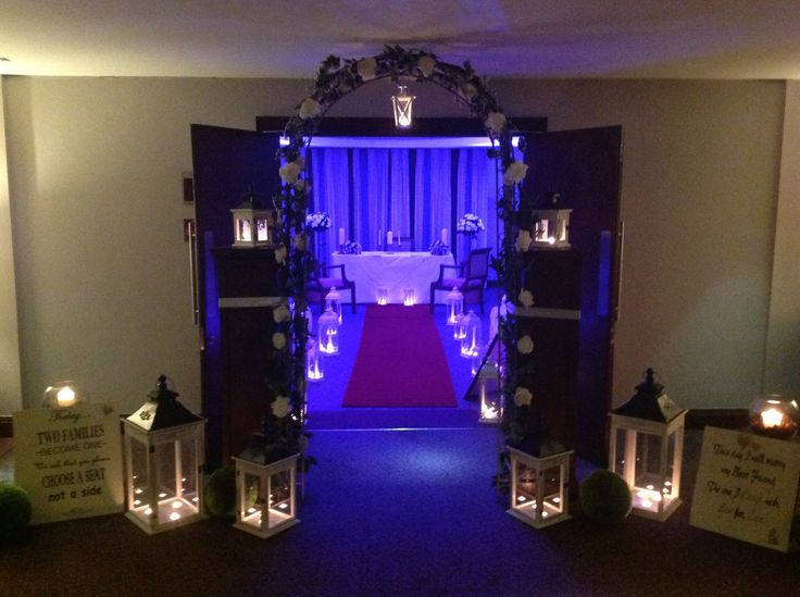Civil Wedding Ceremony set up by RKD Floral Displays complete with lanterns and arch and signs.